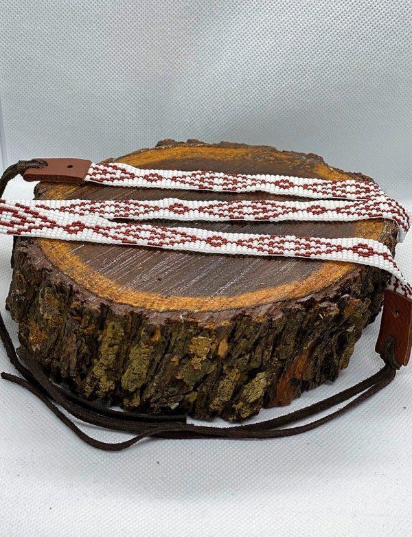 08d67a1f71b065554fb653d8bcfd2be0f48cf880 1 <ul> <li>Hand made beaded hat band</li> <li>One Size Fits 7 1/4 - 7 5/8</li> <li>Glass beads</li> <li>100% leather straps to help tighten the hat band</li> </ul>