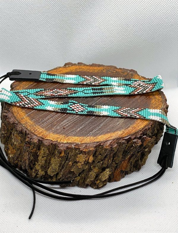 75874ae8e53a193313c0c115a1b03217b56506da 1 <ul> <li>Hand made beaded hat band</li> <li>One Size Fits 6 7/8 - 7 3/8</li> <li>Glass beads</li> <li>100% leather straps to help tighten hat band</li> </ul>