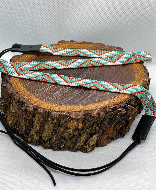 7f02383061df0a8fb69e4316df86e85e0e4360e0 1 <ul> <li>Hand made beaded hat band</li> <li>One Size Fits 7 1/8 - 7 1/2</li> <li>Glass bead</li> <li>100% leather straps to help tighten the hat band</li> </ul>