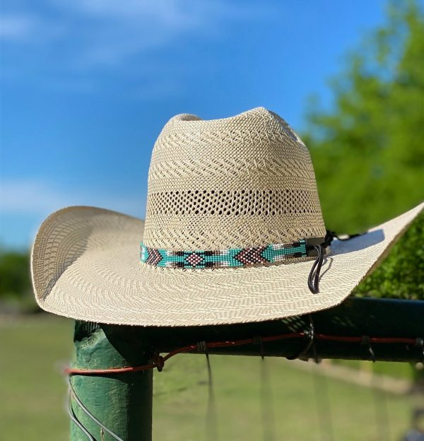 9485f58347dbf7e68c62b442bc520bfbe4702ad6 1 <ul> <li>Hand made beaded hat band</li> <li>One Size Fits 6 7/8 - 7 3/8</li> <li>Glass beads</li> <li>100% leather straps to help tighten hat band</li> </ul>